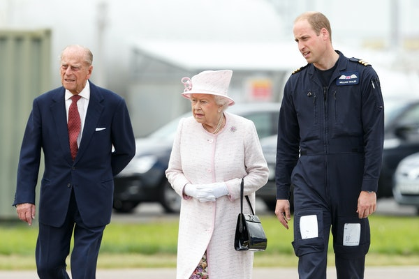 CAMBRIDGE, UNITED KINGDOM - JULY 13: (EMBARGOED FOR PUBLICATION IN UK NEWSPAPERS UNTIL 48 HOURS AFTER CREATE DATE AND TIME) Prince William, Duke of Cambridge gives his grandparents Queen Elizabeth II and Prince Philip, Duke of Edinburgh a tour as they open the new East Anglian Air Ambulance base at Cambridge Airport on July 13, 2016 in Cambridge, England. (Photo by Max Mumby/Indigo/Getty Images)