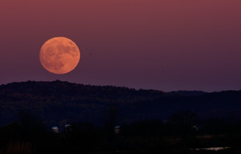 A supermoon happens when the full moon coincides with the moon's closest approach to Earth in its orbit