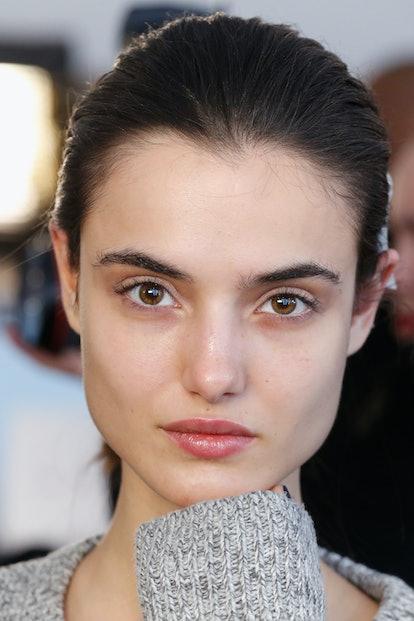 NEW YORK, NY - FEBRUARY 14:  Model, Blanca Padilla prepares backstage at the Jonathan Simkhai fashio...