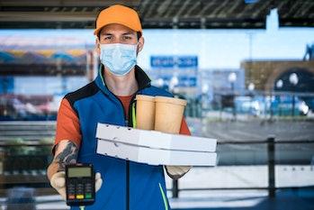 Man wearing mask delivering food