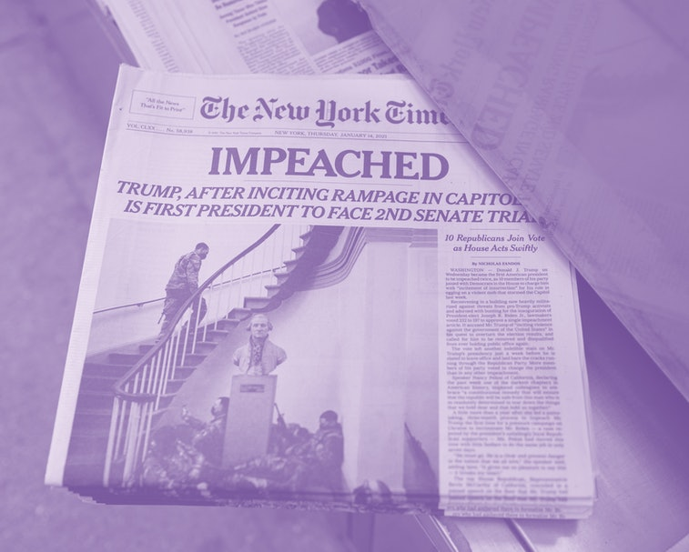 NEW YORK, NY - JANUARY 14: The front page of The New York Times newspaper shows National Guard soldiers bivouacked inside Capitol Hill January 14, 2021 in New York City. The day before on January 13, 2021 President Donald Trump was impeached for the second time in his 4-year term.   (Photo by Robert Nickelsberg/Getty Images)