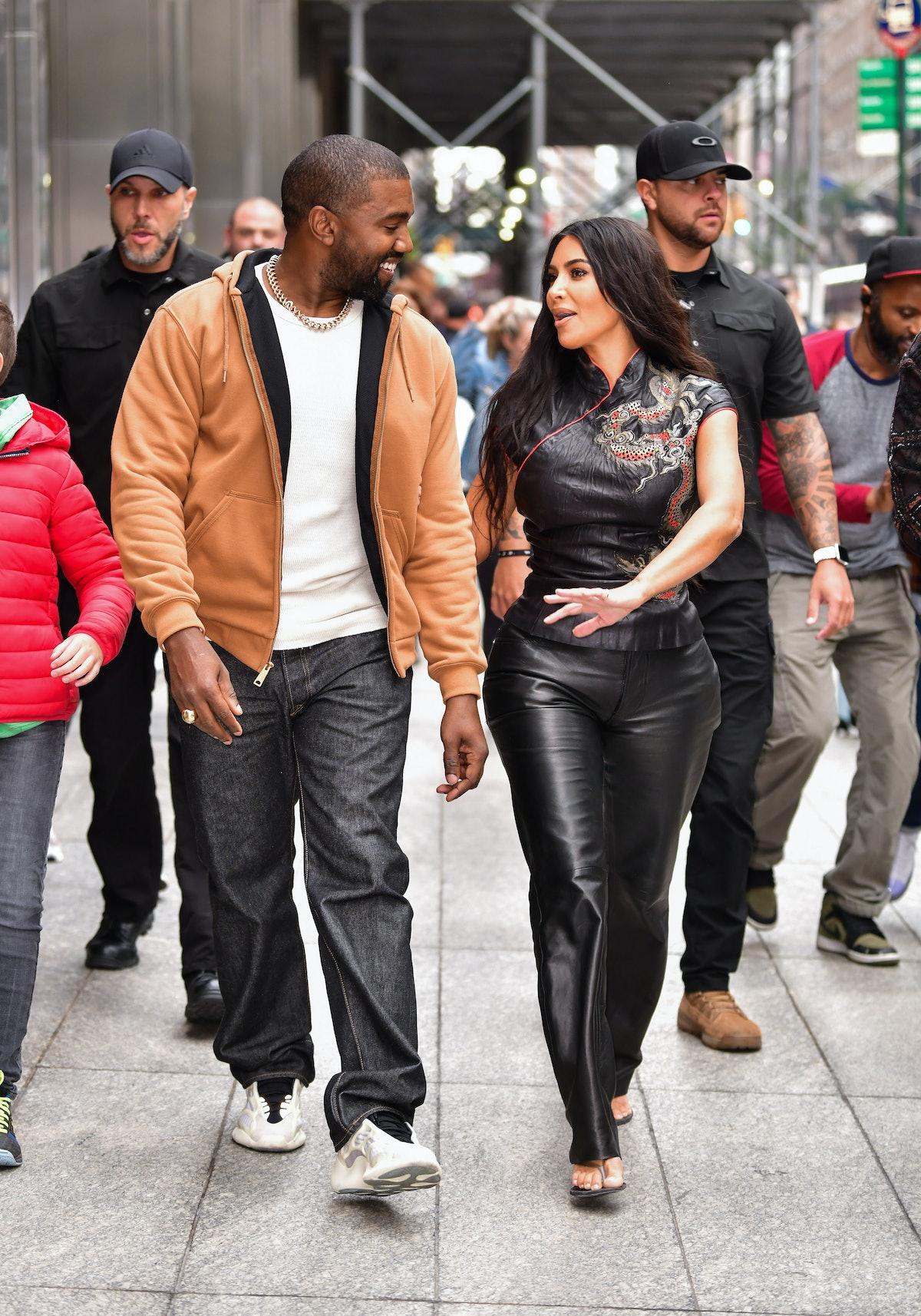 NEW YORK, NY - OCTOBER 25:  Kanye West and Kim Kardashian West walk along 57th Street on October 25,...