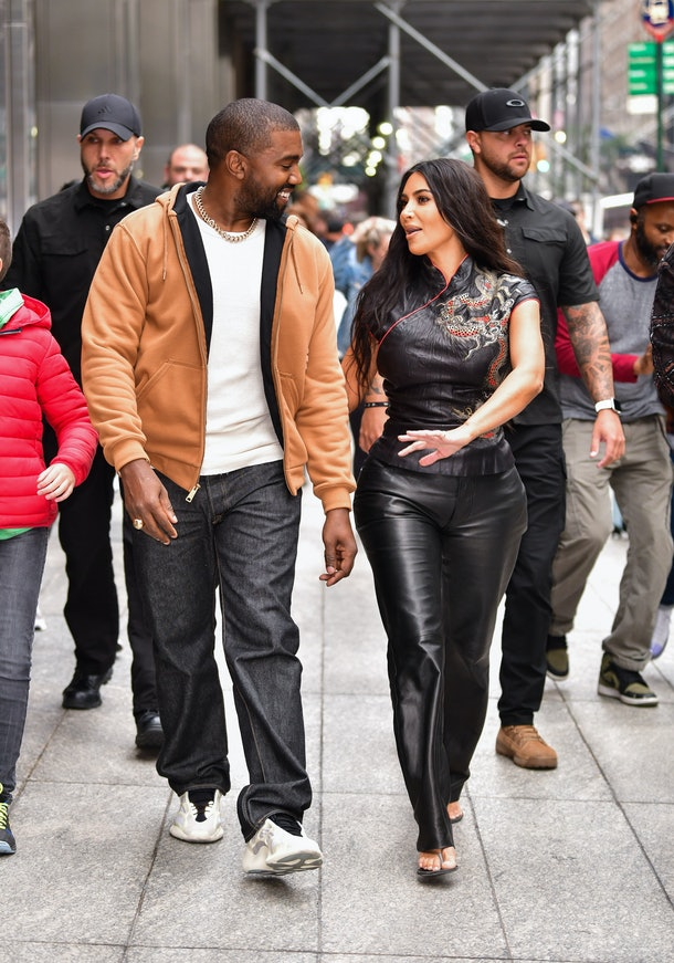 NEW YORK, NY - OCTOBER 25:  Kanye West and Kim Kardashian West walk along 57th Street on October 25, 2019 in New York City.  (Photo by James Devaney/GC Images)