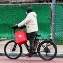 NEW YORK, NEW YORK - DECEMBER 04: A Doordash delivery person rides their bike on Church Avenue in the Flatbush neighborhood of Brooklyn on December 04, 2020 in New York City. Food delivery startup DoorDash Inc is expected to raise its U.S. initial public offering up to $3.14 billion.  (Photo by Michael M. Santiago/Getty Images)