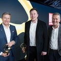 dpatop - 12 November 2019, Berlin: Oliver Zipse (l-r), Chairman of the Board of Management of BMW, Elon Musk, CEO of Tesla, and Herbert Diess, Chairman of the Board of Management of Volkswagen, converse after the presentation of the Golden Steering Wheel. Photo: Jörg Carstensen/dpa (Photo by Jörg Carstensen/picture alliance via Getty Images)