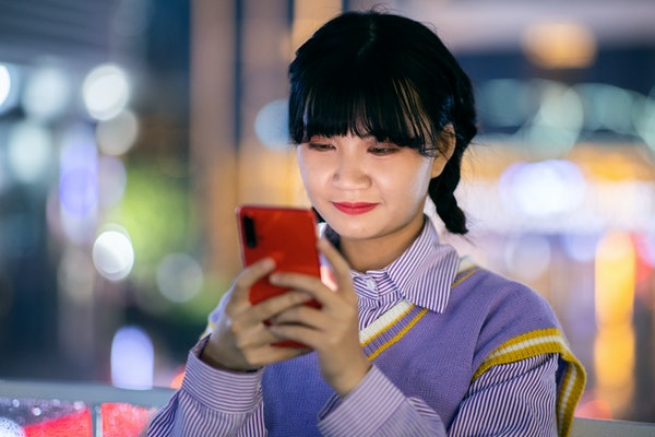 Young woman wondering what to text their crush.