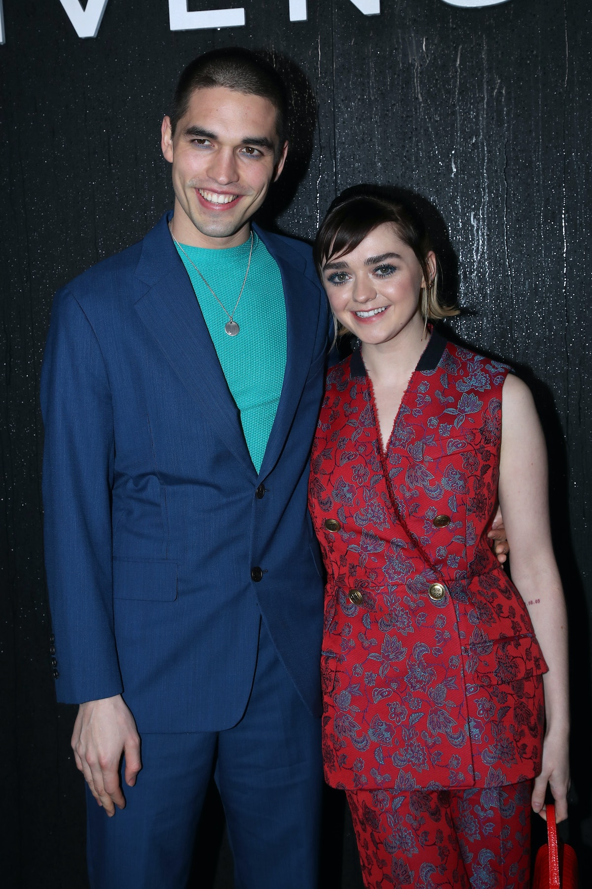 PARIS, FRANCE - MARCH 01: (EDITORIAL USE ONLY) Maisie Williams and her boyfriend Reuben Selby attend...