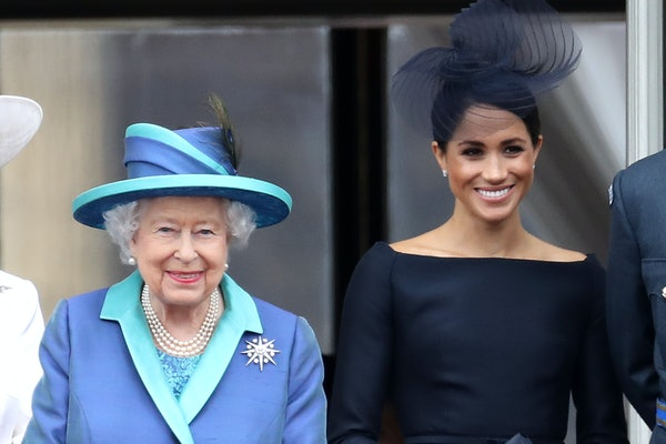 LONDON, ENGLAND - JULY 10: Queen Elizabeth II and Meghan, Duchess of Sussex on the balcony of Buckingham Palace as the Royal family attend events to mark the Centenary of the RAF on July 10, 2018 in London, England. (Photo by Chris Jackson/Getty Images)