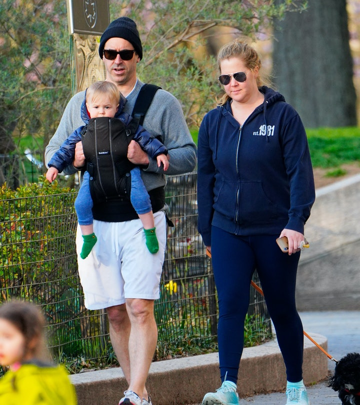 NEW YORK, NEW YORK - APRIL 01: Amy Schumer and husband Chris Fischer take a walk in the park with their son Gene Fischer and the family dog on April 01, 2020 in New York City. (Photo by Jackson Lee/GC Images)