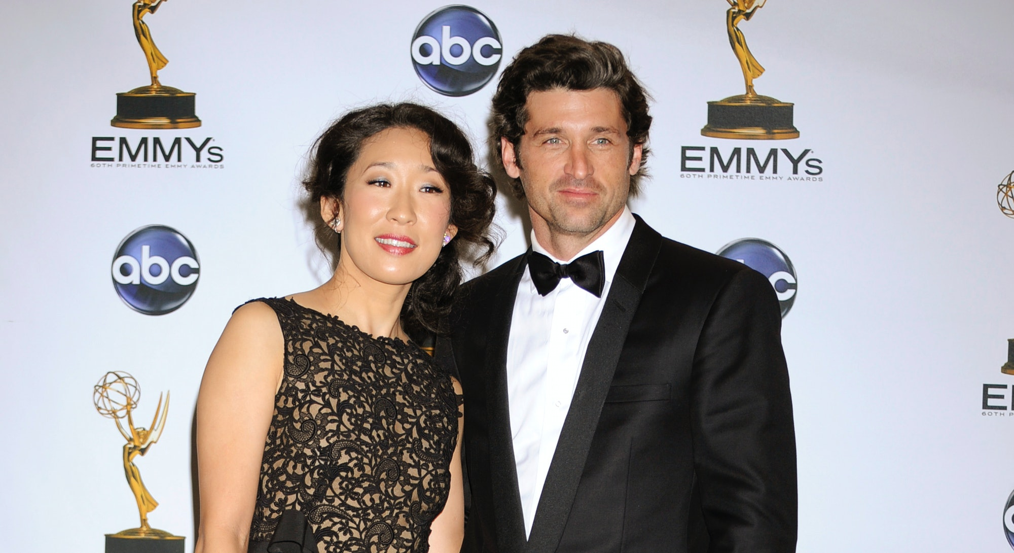 Actress Sandra Oh and actor Patrick Dempsey in the press room at the 60th Primetime Emmy�� Awards held at the Nokia Theatre. Tuxedo by Versace. (Photo by Frank Trapper/Corbis via Getty Images)