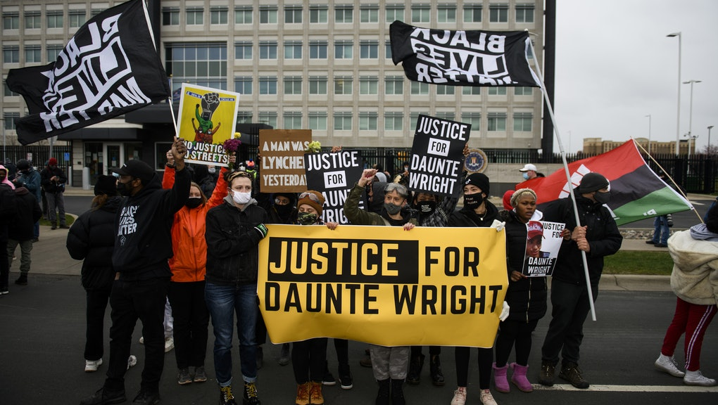 BROOKLYN CENTER, MN - APRIL 13: Protesters march from the Brooklyn Center police headquarters to a n...