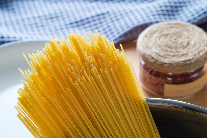 Raw Spaghetti or pasta in a saucepan for cooking and boiling food. Vegetarian and Vegan Food. Home life.