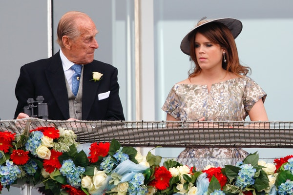 EPSOM, UNITED KINGDOM - JUNE 01: (EMBARGOED FOR PUBLICATION IN UK NEWSPAPERS UNTIL 48 HOURS AFTER CREATE DATE AND TIME) Prince Philip, Duke of Edinburgh and Princess Eugenie of York watch the racing as they attend Derby Day of the Investec Derby Festival at Epsom Racecourse on June 1, 2013 in Epsom, England. (Photo by Max Mumby/Indigo/Getty Images)