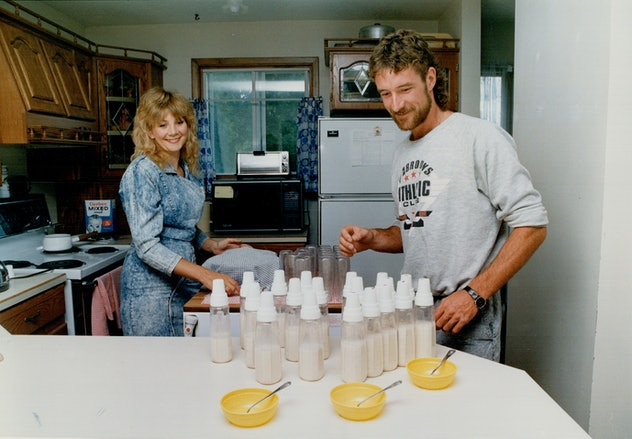 CANADA - JULY 04:  Bottle brigade: Baby feeding time is a big production at the Holland Landing home of Mae and Wayne Collier, the thrilled but wilted parents of test-tube quints who are the darlings of the community.   (Photo by Ken Faught/Toronto Star via Getty Images)