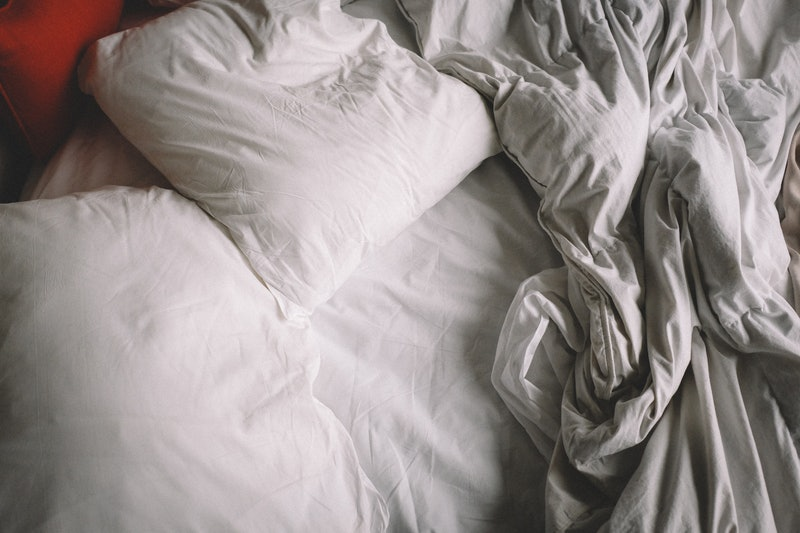 An empty bed with rumpled sheets. Doctors explain why anxiety can throw off your sex drive.