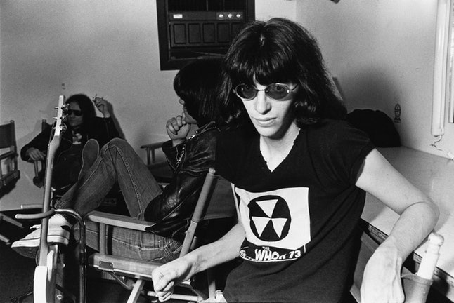 Singer Joey Ramone (1951 - 2001), of American punk group The Ramones, backstage at the Paradise Theater (now the Paradise Rock Club) in Boston, Massachusetts, 22nd March 1978. In the background are bassist Dee Dee Ramone (1951 - 2002, centre) and drummer Tommy Ramone (1949 - 2014). (Photo by Barbara Alper/Getty Images)