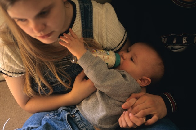 Seven months a mother, Jill Crisler, 16 (in 1997) cares for her son, Trenton before leaving for Nort...