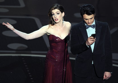 Actors James Franco (R) and Anne Hathaway present the 83rd Annual Academy Awards at the Kodak Theatre late on February 27, 2011 in Hollywood, California. AFP PHOTO / GABRIEL BOUYS (Photo credit should read GABRIEL BOUYS/AFP via Getty Images)