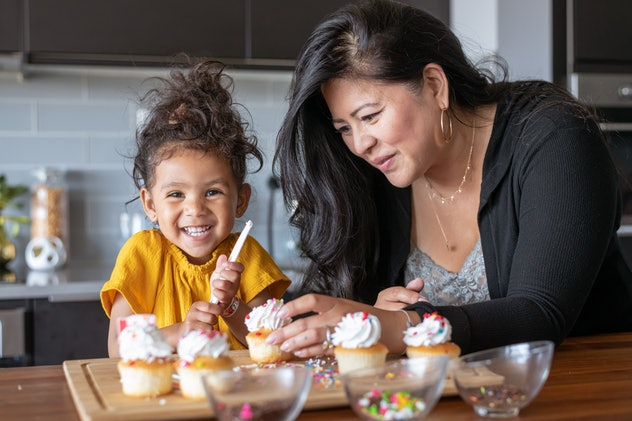 Baking together is a great one-on-one mom and toddler activity.