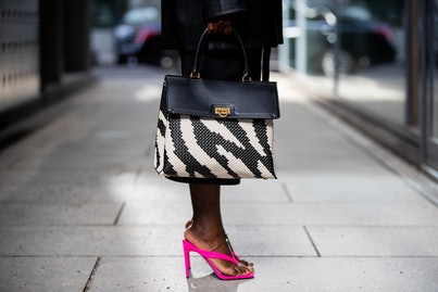 BERLIN, GERMANY - FEBRUARY 25: Lois Opoku is seen wearing black blazer Na-kd, Mango cropped pants, pink Asos heels, Bottega Veneta sunglasses, Ferragamo two tone black white bag on February 25, 2021 in Berlin, Germany. (Photo by Christian Vierig/Getty Images)