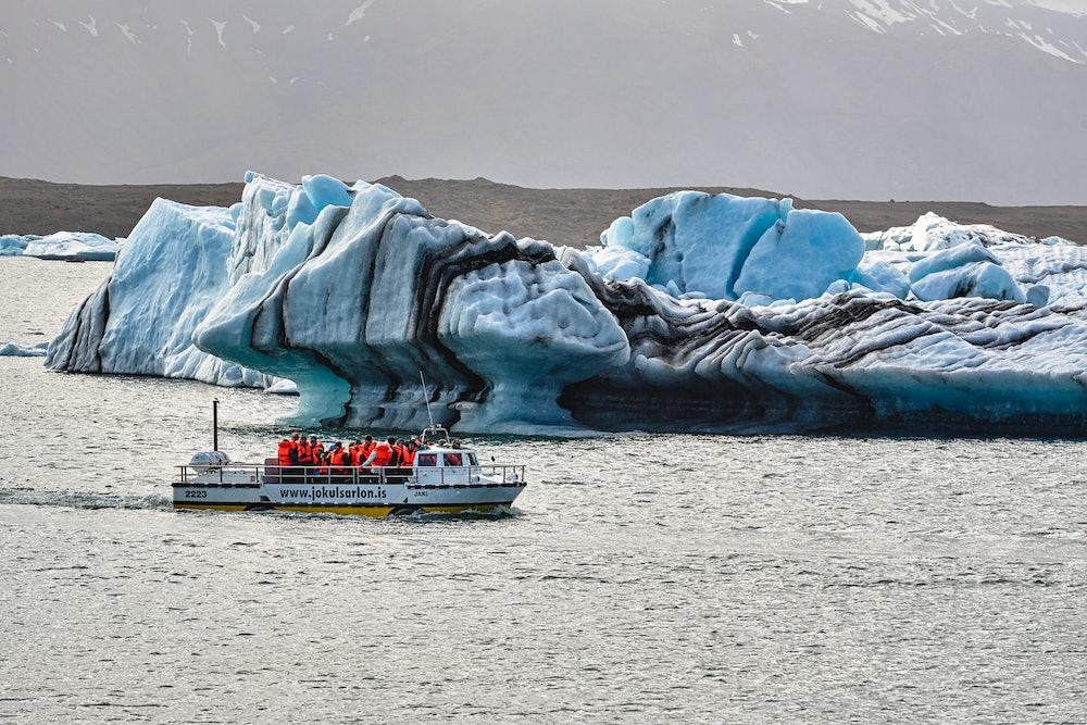 Navigation among the icebergs at Jökulsárlón, a large glacial lake in southern part of Vatnajökull National Park, Iceland. July 2020