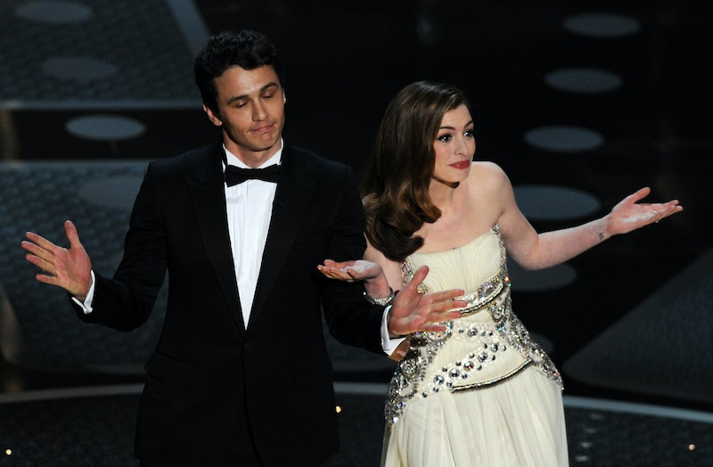 Actor James Franco and actress Anne Hathaway introduce veteran actor Kirk Douglas on stage at the 83rd Annual Academy Awards held at the Kodak Theatre on February 27, 2011 in Hollywood, California. AFP PHOTO / GABRIEL BOUYS (Photo credit should read GABRIEL BOUYS/AFP via Getty Images)