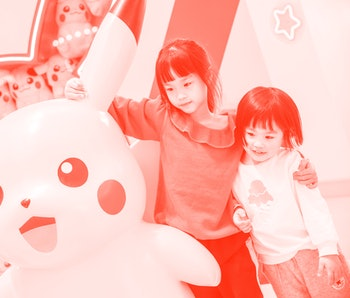FUZHOU, CHINA - APRIL 11: Children pose for a photo with a Pikachu toy during a Pokemon-themed activity at a shopping centre on April 11, 2021 in Fuzhou, Fujian Province of China. (Photo by Li Nanxuan/China News Service via Getty Images)