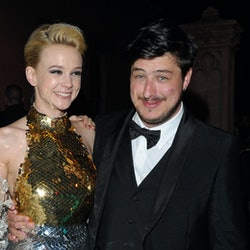 """NEW YORK, NY - MAY 07:   (EDITORS NOTE: This image is a re-crop of original file 144037305)  Carey Mulligan (L) and new husband Marcus Mumford attend the after party for the """"Schiaparelli and Prada: Impossible Conversations"""" Costume Institute exhibition on May 7, 2012 in New York City.  (Photo by Dave Kotinsky/Getty Images)"""