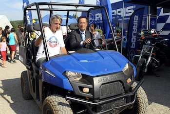 French candidate for the Socialist Party (PS) nomination for France's next year's presidential vote Francois Hollande rides a Polaris electric ranger on September 10, 2011 during the 6th motocross Kenny Festival in Reygades. Every year the Kenny Festival, a French off road event organized at the Motocross circuit in Reygades, hosts more than 1.000 riders for a weekend. AFP PHOTO DIARMID COURREGES (Photo credit should read DIARMID COURREGES/AFP via Getty Images)