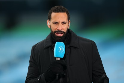 MANCHESTER, ENGLAND - APRIL 10: Rio Ferdinand reporting for BT Sport ahead of the Premier League match between Manchester City and Leeds United at Etihad Stadium on April 10, 2021 in Manchester, United Kingdom. Sporting stadiums around the UK remain under strict restrictions due to the Coronavirus Pandemic as Government social distancing laws prohibit fans inside venues resulting in games being played behind closed doors. (Photo by Robbie Jay Barratt - AMA/Getty Images)