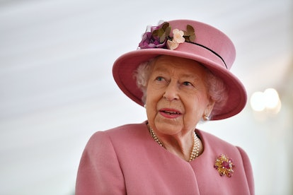 SALISBURY, ENGLAND - OCTOBER 15: Britain's Queen Elizabeth II speaks with staff during a visit to th...