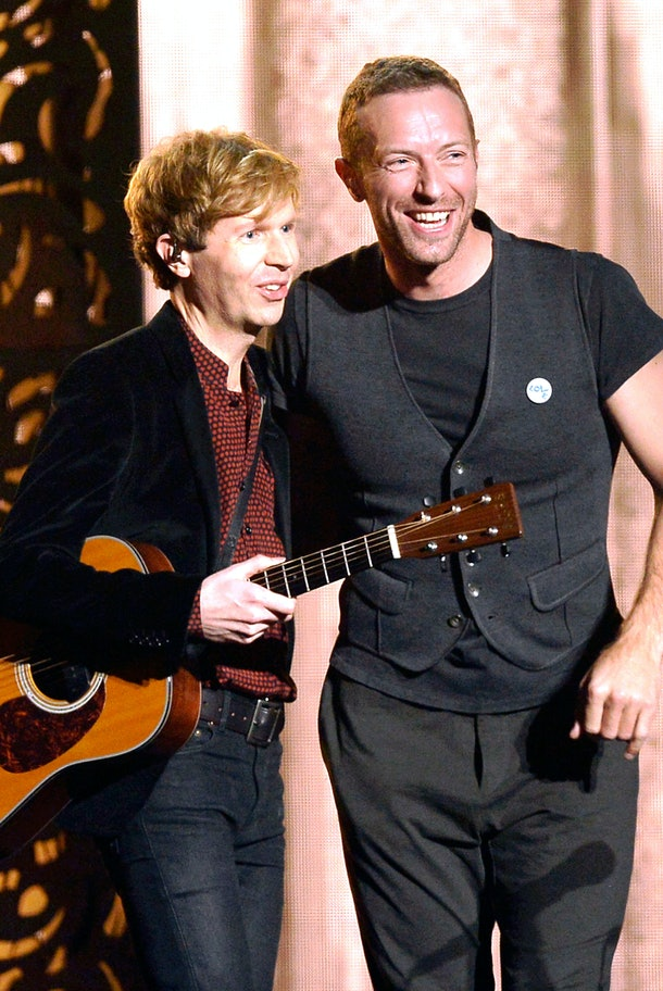 """LOS ANGELES, CA - FEBRUARY 08:  Recording artists Beck (L) and Chris Martin perform """"Heart Is a Drum"""" onstage during The 57th Annual GRAMMY Awards at the at the STAPLES Center on February 8, 2015 in Los Angeles, California.  (Photo by Kevork Djansezian/Getty Images)"""