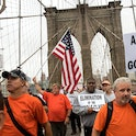 NEW YORK, NY - SEPTEMBER 18: Following a rally in Brooklyn's Cadman Plaza Park, hundreds of union members march across the Brooklyn Bridge in support of IBEW Local 3 (International Brotherhood of Electrical Workers), September 18, 2017 in New York City. More than 1800 members of IBEW Local 3 are entering their sixth month of a strike in a contract dispute with Charter Communications/Spectrum. (Photo by Drew Angerer/Getty Images)