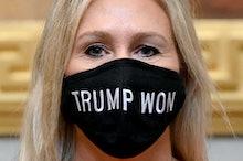 WASHINGTON, DC - JANUARY 3:  Q Anon supporter Marjorie Taylor Greene (R-Ga.) sports a Trump Won mask...