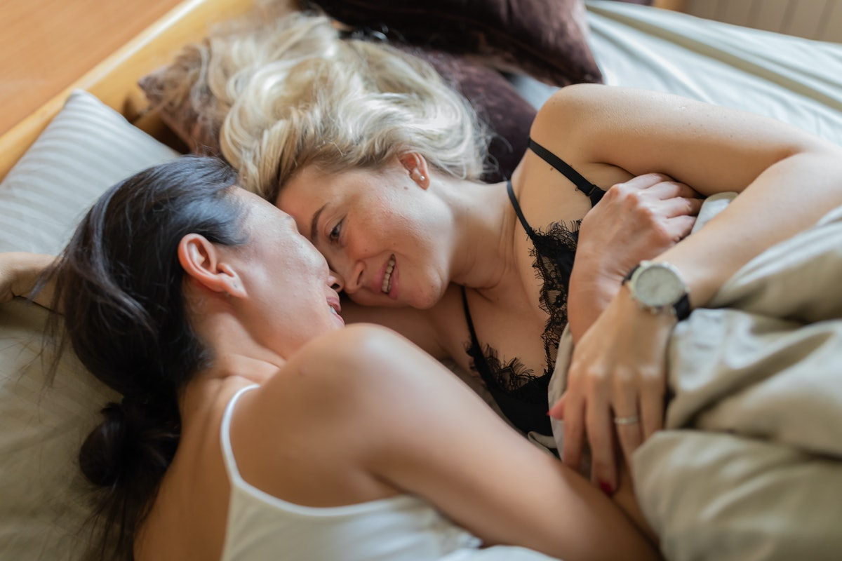 A lesbian couple after making love in bed.