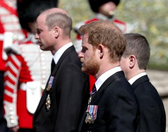 Britain's Prince William, Duke of Cambridge (L) and Britain's Prince Harry, Duke of Sussex follow th...
