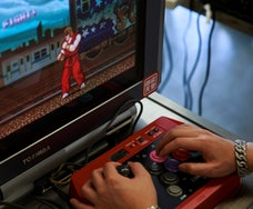 In this photo taken on August 12, 2017, a visitor plays the original 1980s Capcom classic Street Fighter, the precursor to the highly successful Street Fighter II sequel and later follow-ups, during the Retro.HK gaming expo in Hong Kong. / AFP PHOTO / TENGKU Bahar        (Photo credit should read TENGKU BAHAR/AFP via Getty Images)
