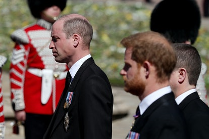 Prince Harry walks behind his grandfather's coffin.