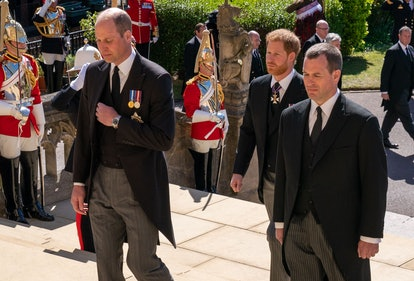 Britain's Prince William, Duke of Cambridge, (L), Britain's Prince Harry, Duke of Sussex, (C) and Peter Phillips (R) follow the coffin into St George's Chapel for the funeral service of Britain's Prince Philip, Duke of Edinburgh in Windsor Castle in Windsor, west of London, on April 17, 2021. - Philip, who was married to Queen Elizabeth II for 73 years, died on April 9 aged 99 just weeks after a month-long stay in hospital for treatment to a heart condition and an infection. (Photo by Arthur EDWARDS / various sources / AFP) (Photo by ARTHUR EDWARDS/AFP via Getty Images)