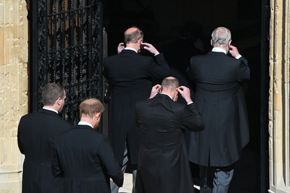 The royal family dons their masks on the way into St. George's Chapel.
