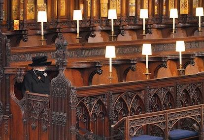 Queen Elizabeth II takes her seat for the funeral service of Britain's Prince Philip, Duke of Edinbu...