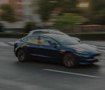 Madrid, Spain - 16 October, 2019: An electric Tesla Model S car in motion in an avenue of Madrid, Spain.