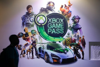 """PARIS, FRANCE - OCTOBER 25: A visitor walks past an poster of the Microsoft subscription service """"Xbox Game Pass"""" during the 'Paris Games Week' on October 25, 2018 in Paris, France. 'Paris Games Week' is an international trade fair for video games and runs from October 26 to 31, 2018.  (Photo by Chesnot/Getty Images)"""