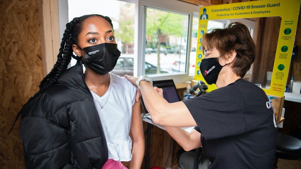 UNITED STATES - APRIL 12: Rishell of Cleveland Park, receives the Johnson & Johnson COVID-19 vaccine from Heidi Johnson, pediatric nurse practitioner, at Grubb's Pharmacy on Capitol Hill on Monday, April 12, 2021. (She declined to give her last name.) (Photo By Tom Williams/CQ-Roll Call, Inc via Getty Images)