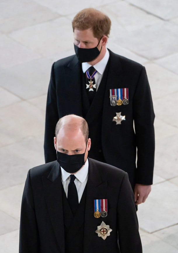WINDSOR, ENGLAND - APRIL 17: Prince William, Duke of Cambridge and Prince Harry, Duke of Sussex follow the coffin of Prince Philip, Duke of Edinburgh, as it is carried into his funeral service at St George's Chapel at Windsor Castle on April 17, 2021 in Windsor, England. Prince Philip of Greece and Denmark was born 10 June 1921, in Greece. He served in the British Royal Navy and fought in WWII. He married the then Princess Elizabeth on 20 November 1947 and was created Duke of Edinburgh, Earl of Merioneth, and Baron Greenwich by King VI. He served as Prince Consort to Queen Elizabeth II until his death on April 9 2021, months short of his 100th birthday. His funeral takes place today at Windsor Castle with only 30 guests invited due to Coronavirus pandemic restrictions. (Photo by Danny Lawson - WPA Pool/Getty Images)