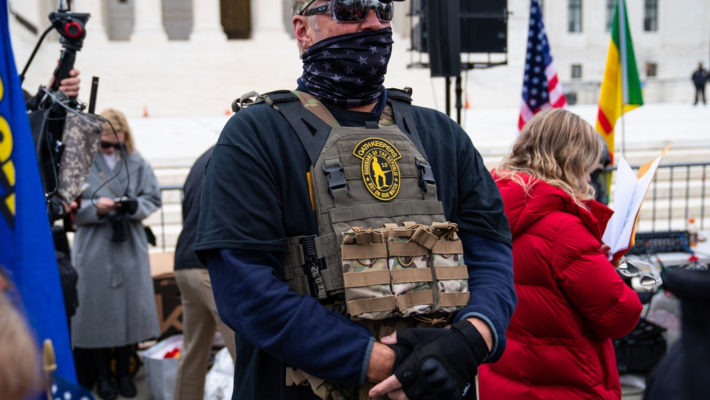 WASHINGTON, DC - JANUARY 05: A member of the right-wing group Oath Keepers stands guard during a rally in front of the U.S. Supreme Court Building on January 5, 2021 in Washington, DC. Today's rally kicks off two days of pro-Trump events fueled by President Trump's continued claims of election fraud and a last-ditch effort to overturn the results before Congress finalizes them on January 6.  (Photo by Robert Nickelsberg/Getty Images)