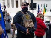 WASHINGTON, DC - JANUARY 05: A member of the right-wing group Oath Keepers stands guard during a ral...
