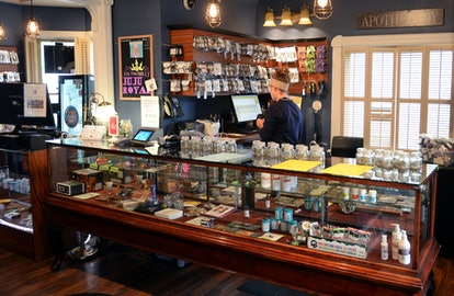 DENVER, CO - April 25, 2016: A budtender organizes and inventories marijuana flower at The Health Ce...