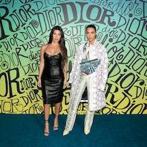 MIAMI, FLORIDA - DECEMBER 03: Kourtney Kardashian and Kim Kardashian West attend the Dior Men's Fall 2020 Runway Show on December 03, 2019 in Miami, Florida. (Photo by Dimitrios Kambouris/Getty Images for Dior Men)