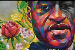 DENVER, COLORADO - MAY 7: A mural of George Floyd is painted on a wall along Colfax Avenue on June 7...